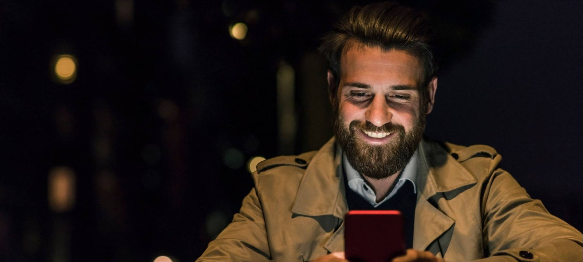 Featured Jobs - Man Smiling At Phone